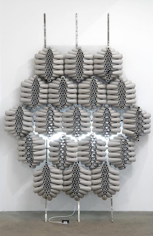 Sam Basu Undecidability Meme Diffusion 2007, cardboard bobbins, wire, aluminium, fluorescent light 260 x 185 x 50 cm
